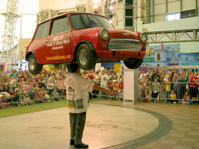 john evans balancing a mini, with advertising on the door. :Why not advertise your product or company right there...